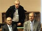 B�val� ministr obrany Martin Bart�k u soudu (20. ledna 2014)