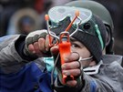 Protivládní demonstrant v centru Kyjeva (28. ledna 2014)