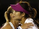Li Na of China and Dominika Cibulkova of Slovakia hug after their women's...
