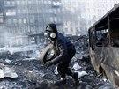 St�ety opozice s polici� v centru Kyjeva pokra�uj� (26. ledna 2014).