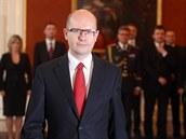 Premiér Bohuslav Sobotka při jmenování ministrů svého kabinetu na Pražském hradě. (29. ledna 2014)