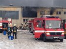 V areálu bývalých mrazíren v Kladně hořel uskladněný polystyren (31.1.2014)