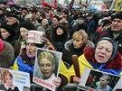 V centru Kyjeva se opět demonstrovalo proti vládě. Lidé přinesli transparenty...