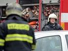 Snímky ze zásahu hasičů u úterního požáru paneláku na Halasově náměstí v Brně.