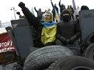 Ulice Kyjeva jsou stále plné demonstrantů (12. února)