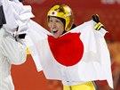 Japonský skokan Noriaki Kasai získal v olympijskému závodu na velkém můstku stříbrnou medaili. (15. února 2014)