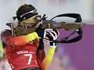 Německá biatlonistka Evi Sachenbacherová-Stehleová při olympijském závodu ve smíšené štafetě. (19. února 2014)