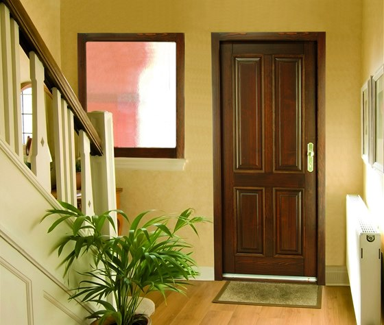 I vchodové dveře je možné sladit se stylem domu.