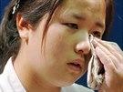 Dcera Megumi Kim po setkání se svými prarodiči.