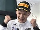 Kevin Magnussen z McLarenu slaví třetí místo z Velké ceny Austrálie formule 1....