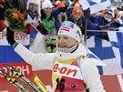 Kaisa Mäkäräinenová slaví triumf ve sprintu v Kontiolahti.