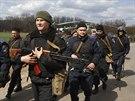 Ukrajinští vojáci ve městě Izjum asi 125 kilometrů na jihovýchod od Charkova....