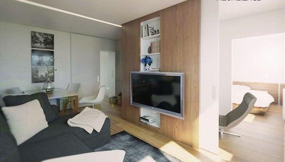 Pohled do ložnice z obývací části, průchod lze uzavřít posuvnými dveřmi