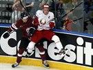 Momentka z utkání hokejového MS mezi domácím Běloruskem a Lotyšskem.