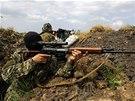 Ozbrojenci z řad separatistů nedaleko východoukrajinského Slavjansku (15.