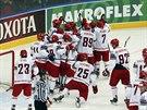 SL�VA V�T�Z�M. Hokejist� B�loruska se raduj� z t�sn�ho v�t�zstv� 4:3 proti...
