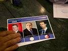 Muž hlasoval pro Bašára Asada během probíhajících prezidentských voleb v Sýrii,...