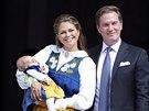 Švédská princezna Madeleine, její manžel Chris O'Neill a jejich dcera, princezna Leonore oslavili státní svátek Švédského království (Stockholm, 6. května 2014).