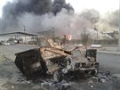 Oho�el� auta v ir�ck�m Mosulu, kter�ho se zmocnili radik�ln� islamist� (Ir�k,...