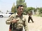 Člen kurdských jednotek ve městě Kirkúk (25. června)