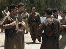 Členové kurdských jednotek ve městě Kirkúk (25. června)