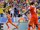 Nizozemský útočník Klaas-Jan Huntelaar (vlevo) slaví vítězný gól v osmifinále...