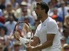 COME ON! Bulharský tenista Grigor Dimitrov se raduje ze zisku druhého setu ve...