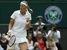 JO! �esk� tenistka Petra Kvitrov� se raduje z poveden� v�m�ny ve fin�le...