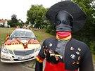 Velký fanoušek německé fotbalové reprezentace Marcel Klingbiel vozí zákazníky...