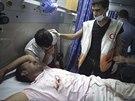 Zraněný Palestinec během zesílené izraelské ofenzivy (18. července 2014)