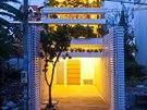Dům se zelenou fasádou postavil Vo Trong Nghi v Ho Či Minově Městě pro rodinu...