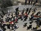 Pohřeb Palestinců zabitých při izraelských náletech (12. 7. 2014).