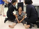 Příbuzní pasažérů letu společnosti TranAsia se dozvěděli o smrti svých blízkých...