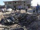 Trosky vládní stíhačky v Benghází. MiG se zřítil a explodoval během úterních...