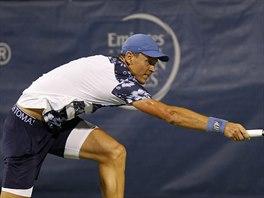 Tomáš Berdych na turnaji ve Washingtonu, kde v prvním kole přehrál Robbyho...