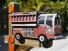 A mailbox in the shape of a fire truck is seen along the highway US-1 in the...