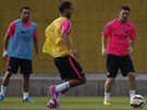 Lionel Messi během tréninku v Barceloně, vlevo Xavi Hernández.
