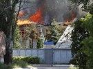V Doněcku vyhořela budova telefonní společnosti Ukrtelecom (10. srpna 2014).