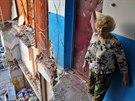 Raisa Jelisjevová v troskách domu v Mikolajevce nedaleko Slavjansku, který...