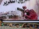 Palestinsk� d�ti se koukaj� pod plak�tem podporuj�c� palestinsk� hnut� v Raf�hu...