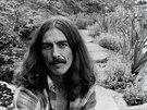 Mystický zámeček Friar Park (v pozadí) koupil Harrison v roce 1970. Součástí...