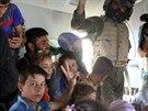 Evakuace Turkemů z Amirlí (30. srpna 2014).