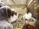 Muslim pilgrims shop at a jewellery near the Grand Mosque during the annual Haj...
