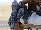Kurdsk� uprchlice ze S�rie na hranic�ch s Tureckem (26. z��� 2014).