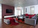 Šedou pohovku Flexteam oživují červené polštáře a prostoru vévodí svítidlo