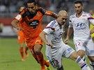 Souboj o míč v podání Christopheho Jalleta z Lyonu (uprostřed) a Walida...