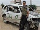 John Cantlie u auta syrských rebelů v Aleppu v listopadu 2012