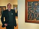 Známý historik umění a jeden z kurátorů ostravské výstavy Karel Srp sotjí u obrazu Bohumila Kubišty nazvaného Podobizna prof. Posejpala. (2. října 2014)