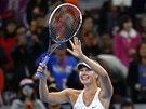 VÍTĚZNÝ ÚSMĚV. Maria Šarapovová po finále turnaje v Pekingu.