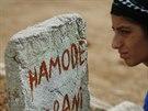 P��buzn� u hrobu Hamode, kter� byl zabit v boji proti Isl�msk�mu st�tu v Kobani...